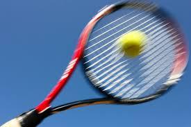 Tennis racquet hitting ball