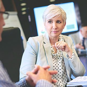 Woman listening carefully other colleague